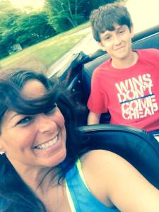 Mother and son tooling around in the convertible